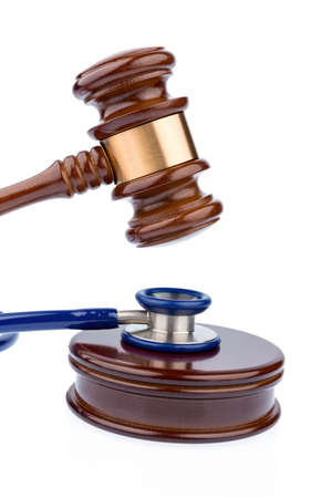 physican: gavel and stethoscope, symbol photo for bungling doctors and error