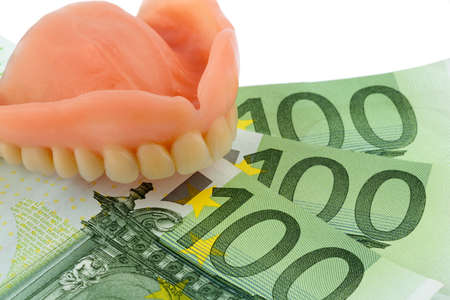 denture and euro bills, symbolic photo for dentures, treatment costs and payment photo