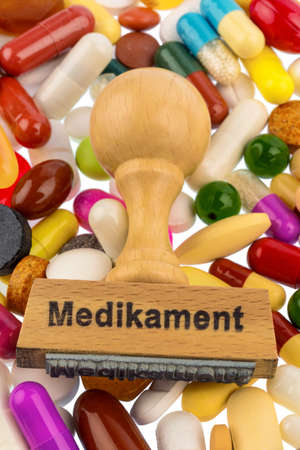 side effect: stamp on colorful tablets, symbol photo for drug therapy and prescription