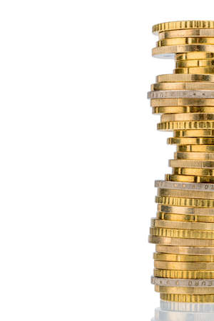 stack coins against white background. symbolic photo for taxes, fees and costs Stock Photo