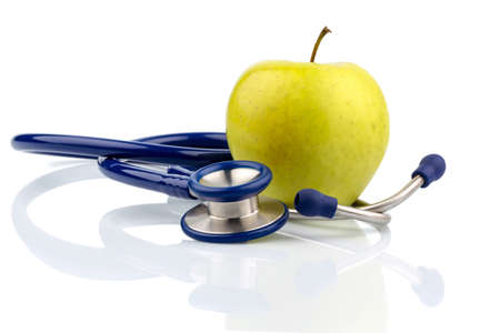 an apple and a stethoscope on a doctor. symbolic photo for healthy and vitamin-rich diet. Stock Photo - 24002547