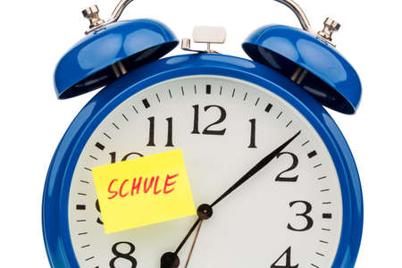 arouse: an alarm clock with a sticky note: school as a symbol photo for start of school