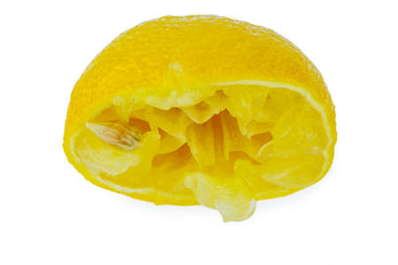a squeezed lemon on a white background. symbolic photo for taxes and fees.