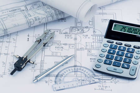 construction draftsman: an architects blueprint with a calculator. symbolic photo for funding and planning of a new house. Stock Photo