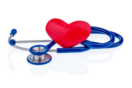 a heart and a stethoscope are adjacent. symbolic photo for heart disease and heartache. photo