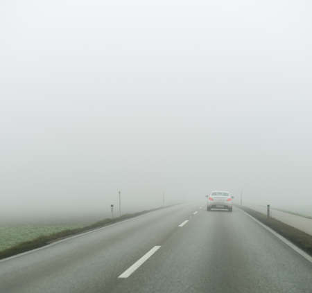 car driving in the fog. poor visibility for drivers in foggy weather. Stock Photo - 24733087