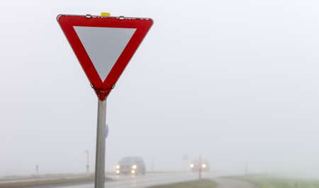 car driving in the fog. poor visibility for drivers in foggy weather. Stock Photo - 24733089