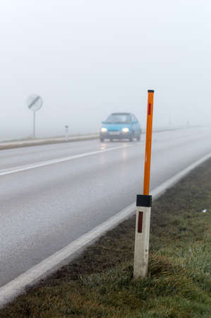 bleak: car driving in the fog. poor visibility for drivers in foggy weather. Stock Photo
