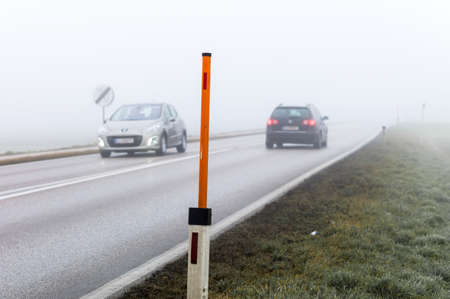 car driving in the fog. poor visibility for drivers in foggy weather. Stock Photo - 24733091