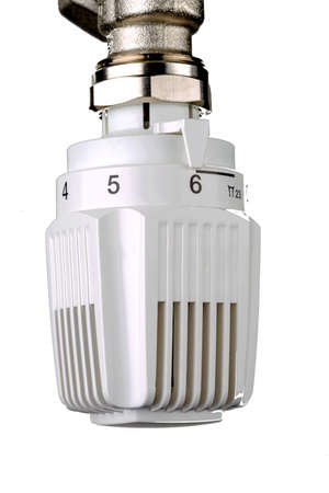 wasteful: the thermostat of a radiator is turned up. high room temperature result in high energy costs