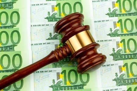 judge gavel and euro banknotes. symbol photo for r costs in court of law and auctions photo