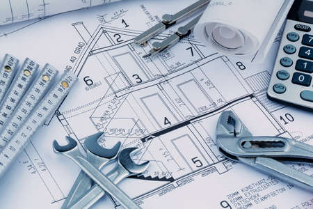 immobilien: an architects blueprint with a calculator. symbolic photo for funding and planning of a new house. Stock Photo