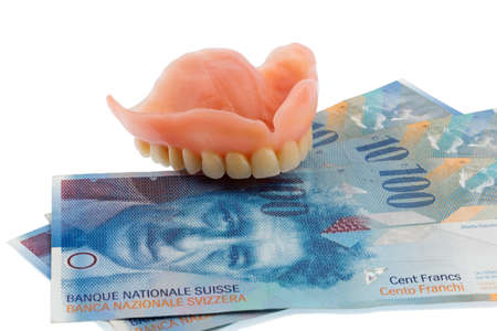 dentition: dentition and the swiss franc symbol photo for dentures, treatment costs and payment