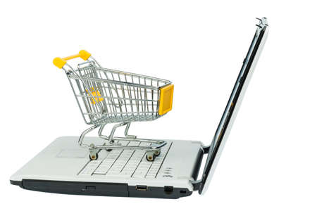 consumerist: an empty shopping cart on a laptop computer. symbolic photo for shopping on the internet