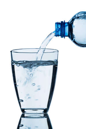 from a bottle of water being poured into a glass, symbol photo for drinking water demand and consumption Stock Photo - 24826081