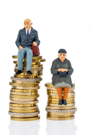 money stack: pensioners and pensioner sitting on money stack, symbol photo for retirement and inequality,