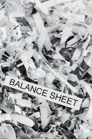 shredding: shredded paper tagged with balance sheet, symbol photo for data destruction, budgets and accounting