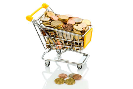 a shopping cart is well stocked with euro coins, symbolic photo for purchasing power and consumption Stock Photo