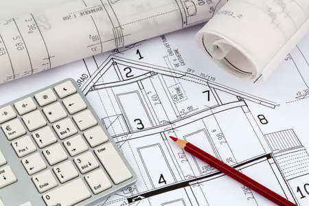 construction draftsman: an architects blueprint for the construction of a new residential house. symbolic photo for funding and planning of a new house. Stock Photo