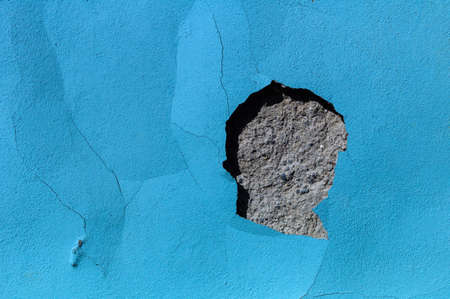 substantiate: flaked blue color on a building
