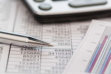 a calculator is on a balance sheet figures are statistics.