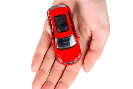 fully comprehensive: hand holding model of a car.  Stock Photo