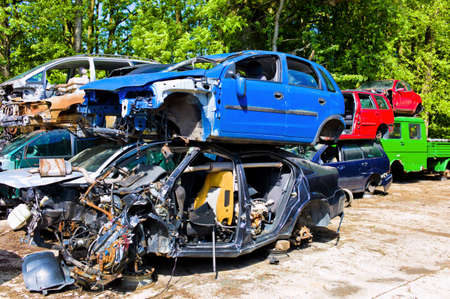 junkyard, broken cars, scrapping of old vehicles photo