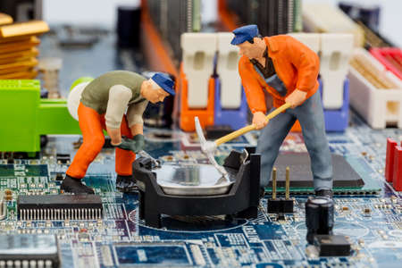 computer board and workers Stock Photo - 24916656
