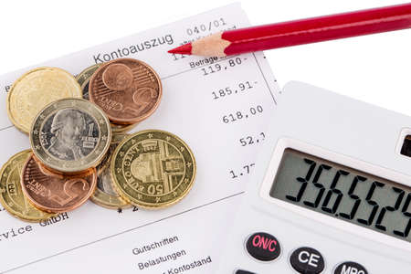 minimum wage: the bank statement and some coins of euro currency Stock Photo