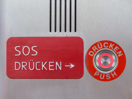 cry for help: the sos button of a call box on a railway station Stock Photo