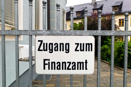 auditors: access to a tax office is blocked by a gate.