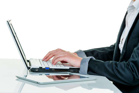 a woman working in an office with a laptop computer Stock Photo