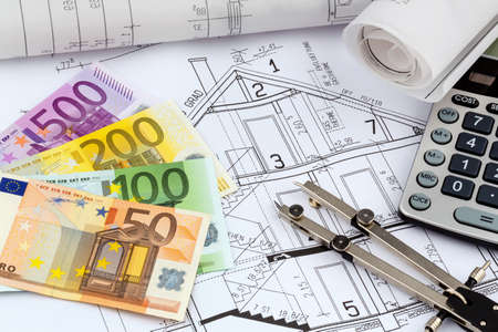 an architects blueprint with a calculator and euro money.  Stock Photo