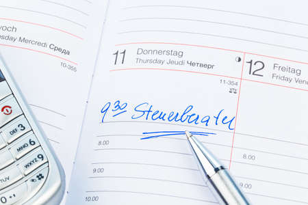 auditors: a date is entered on a calendar: tax consultants