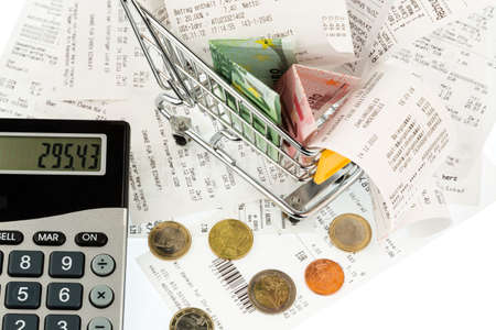 household money: shopping cart, bills and receipts Stock Photo