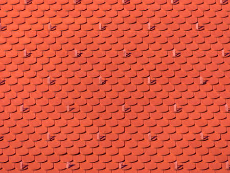 the roof of an old building (church) has been newly renovated. new tiles on house Stock Photo - 25079108
