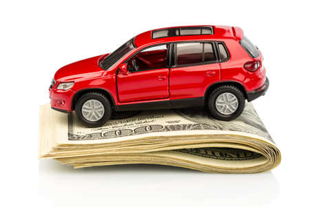 Leasing: a car stands on dollar banknotes.  Stock Photo