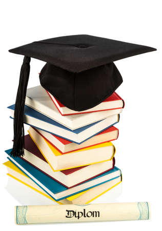 a mortarboard on a book stack photo