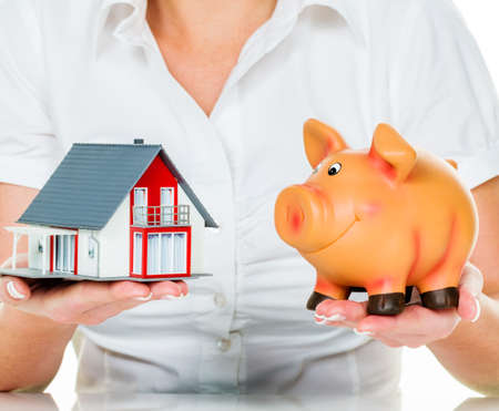 familiy: a woman with a house and a piggy bank. the right financing for the home purchase.