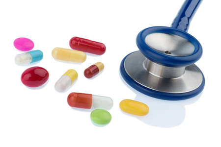 interactions: colorful tablets and a stethoscope, symbol photo for diagnostics, heart disease and interactions