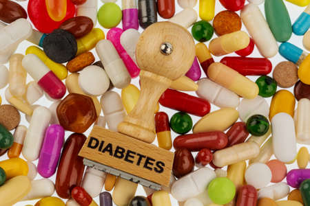 antidiabetic: stamp on colorful tablets, symbol photo for diabetes, prescription and medication Stock Photo