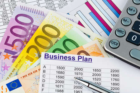 a business plan for starting a business. ideas and strategies for self-employment. euro banknotes and calculator photo