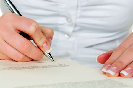 notieren: hand with fountain pen signing contract. sign woman while