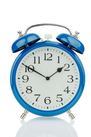 a blue alarm clock on white background. a wake white dial photo