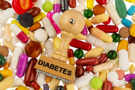 mellitus: stamp on colorful tablets, symbol photo for diabetes, prescription and medication Stock Photo