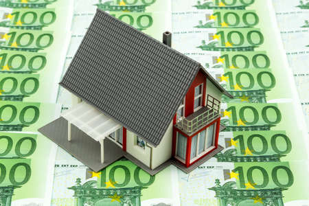 home purchase: residential house on banknotes, symbolic photo for home purchase, financing, building society Stock Photo
