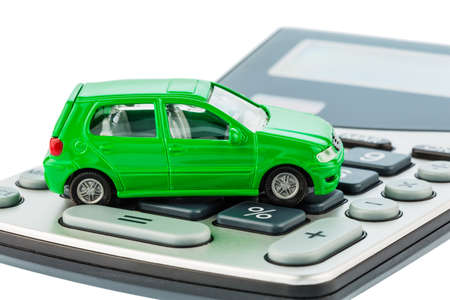 a car is on a calculator. cost of gasoline, wear and insurance. car costs are not paid by commuter tax. photo