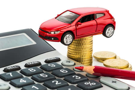 car and calculator. rising costs for car purchase, lease, workshop, refueling and insurance Stock Photo