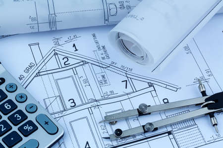 draftsman: an architects blueprint with a calculator. symbolic photo for funding and planning of a new house. Stock Photo