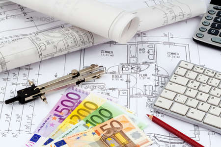 single familiy: an architects blueprint with euro money. symbolic photo for funding and planning of a new house. Stock Photo